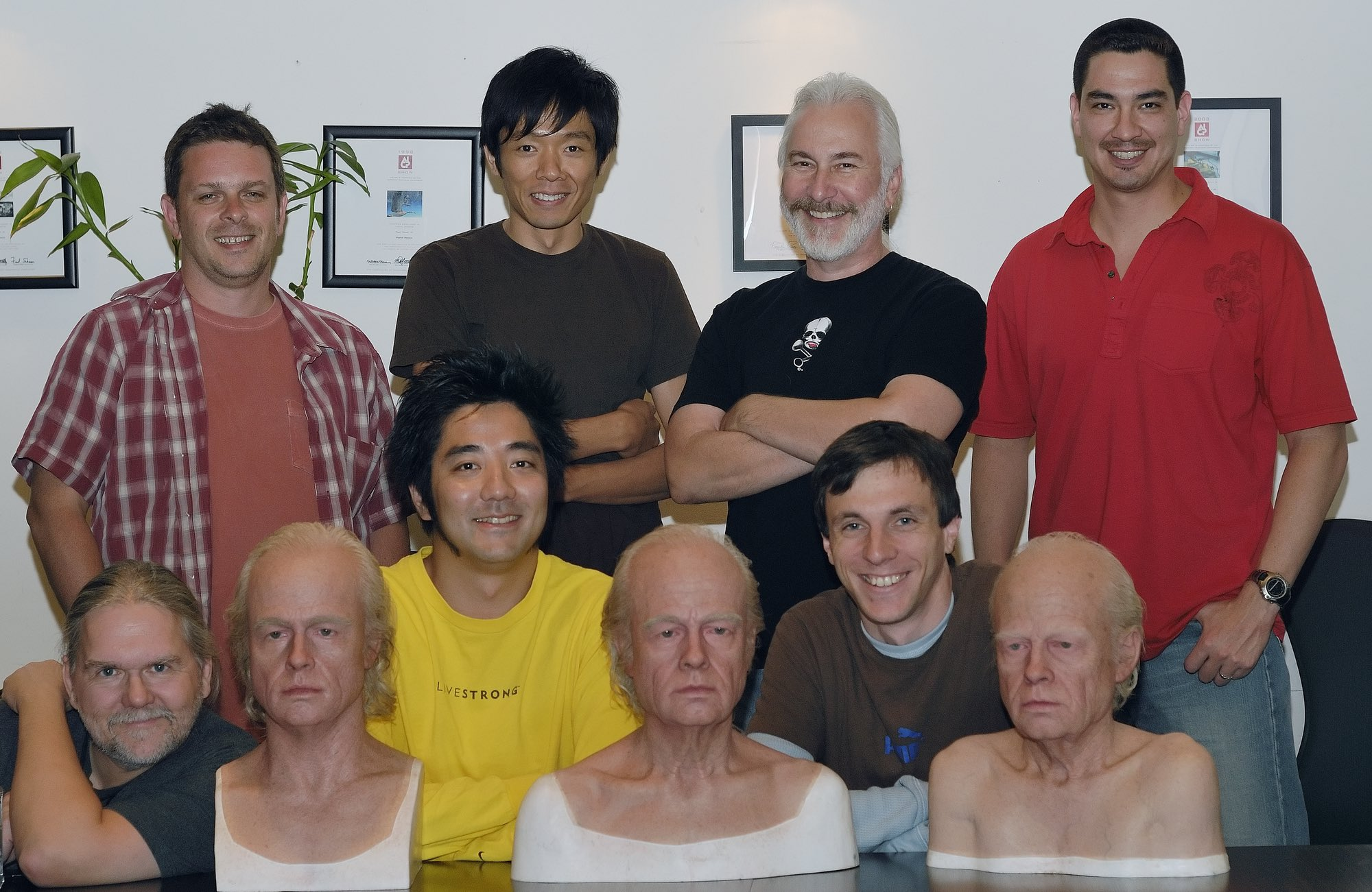 2006. Rick Baker's Cinovation Studios deliver the Brad Pitt heads by Kazu Hiro to Digital Domain